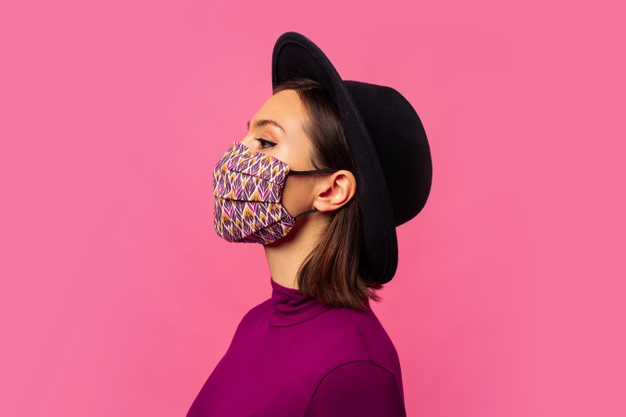 young-brunette-girl-wearing-respiratory-face-mask-against-coronavirus_273443-3987.jpg
